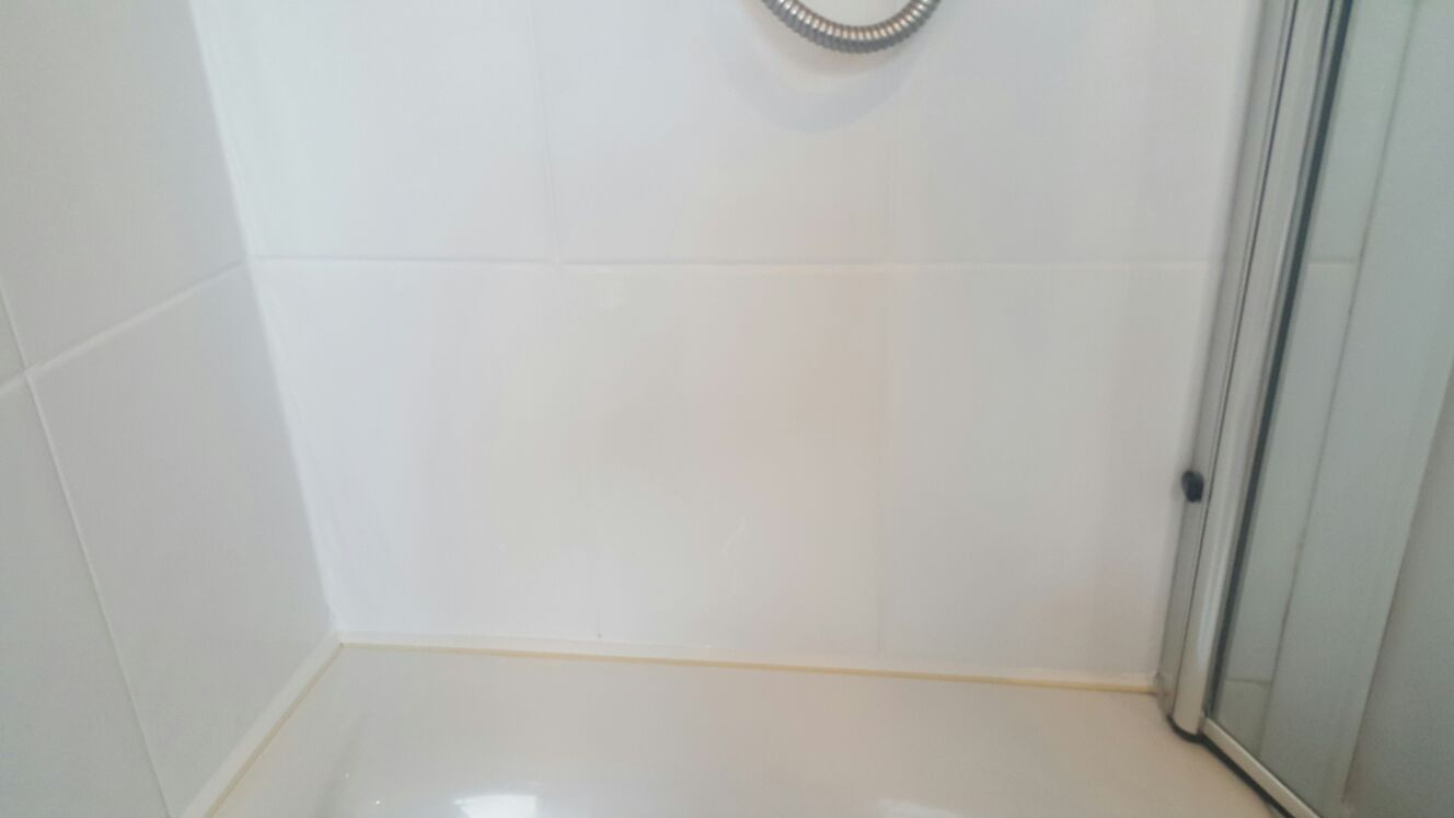 Cleaning Grout In A Ceramic Tiled Shower Cubicle Stone Cleaning And Polishing Tips For Ceramic
