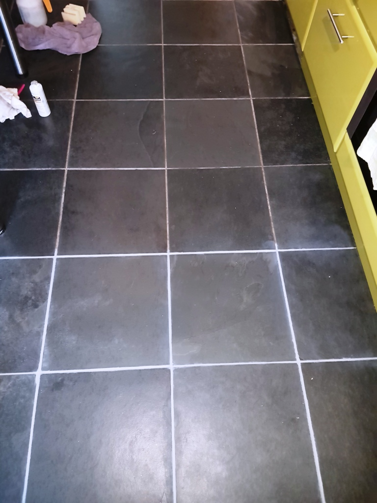 Slate floor tiles during grout colouring in Linwood